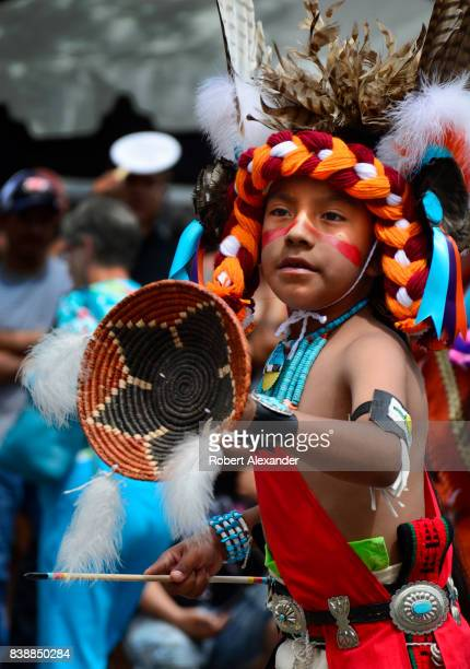 Young Native American members of the Edaakie Junior Dance Group from Zuni Pueblo near Gallup New Mexico perform at the Santa Fe Indian Market in...