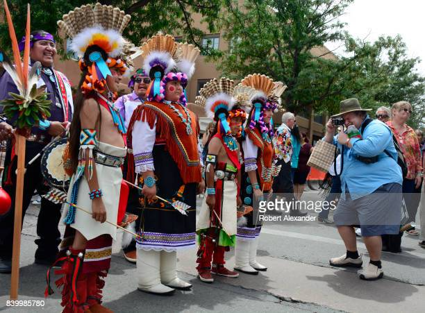 Young Native American members of the Edaakie Junior Dance Group from Zuni Pueblo near Gallup New Mexico pose for photographs at the Santa Fe Indian...