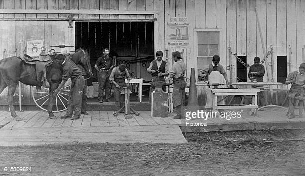 Young Native American men in blacksmithing class at Forest Grove School Oregon 1882 | Location Forest Grove Oregon USA