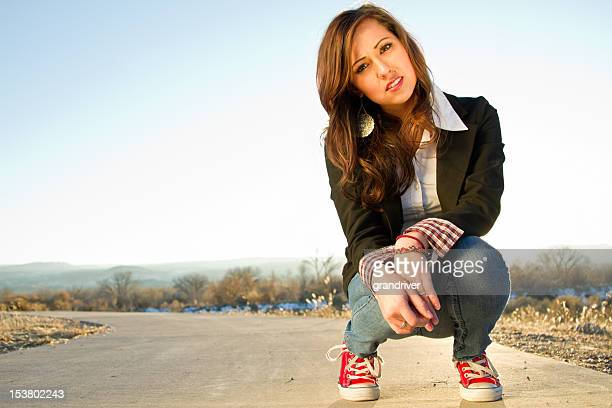 young native american woman crouching - black blazer stock pictures, royalty-free photos & images