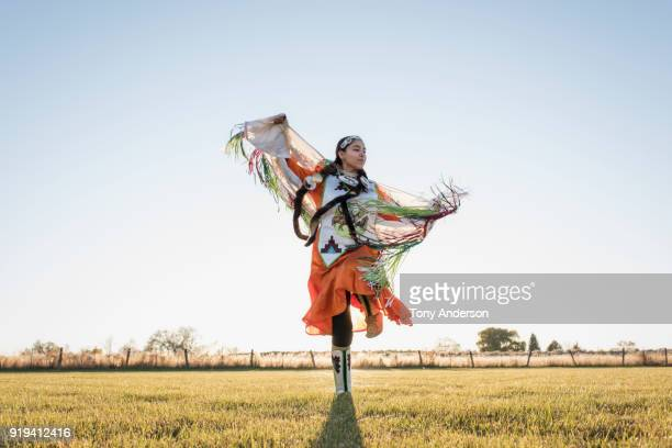 young native american woman dancing in traditional dress - tradition stock pictures, royalty-free photos & images