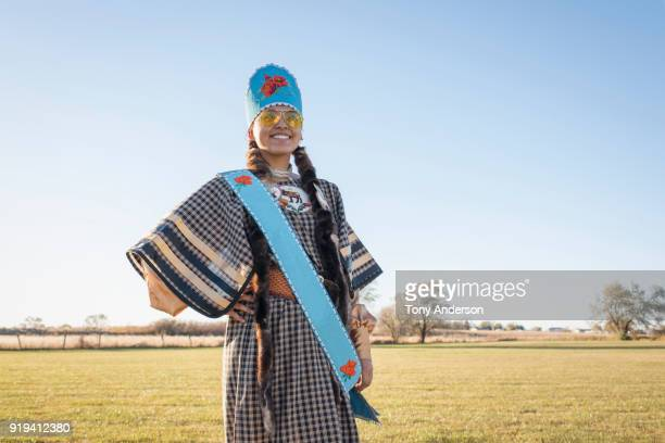 Young Native American woman in traditional regalia
