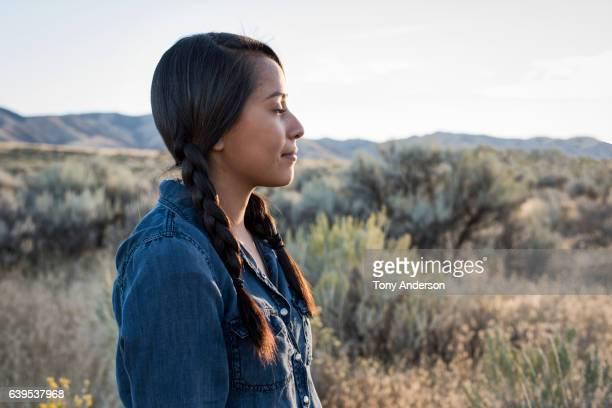 young native american woman outdoors at sunset - femme indienne photos et images de collection