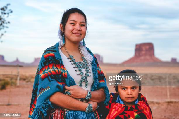 a young navajo brother and sister who live in monument valley, arizona - indigenous culture stock pictures, royalty-free photos & images