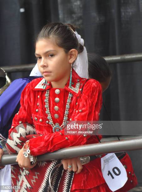A young Navajo girl waits her turn to compete in the Native American Clothing Contest at the annual Santa Fe Indian Market in Santa Fe New Mexico on...