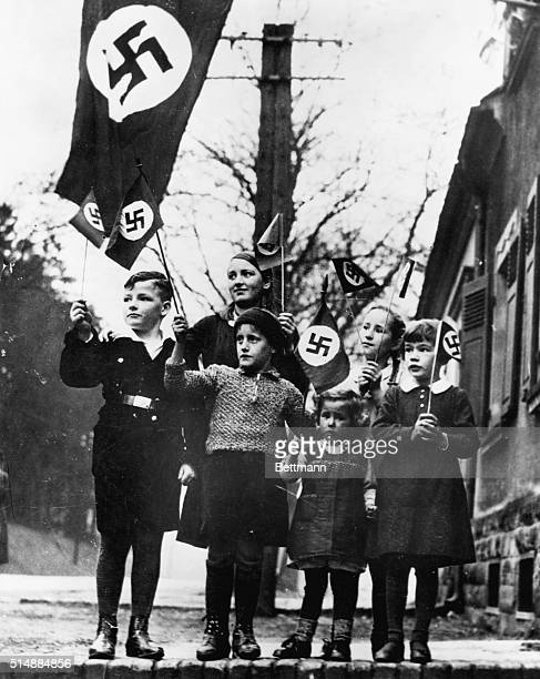 Young Nazi supporters wave flags in the Saar Territory in Germany 1934 | Location Saar Territory Germany