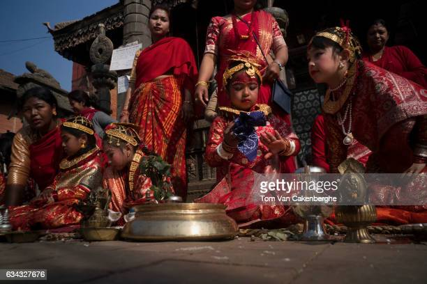 Young Nepalese girls dressed up as brides accompanied by their mothers take part in the Bel Bibaha ritual celebrated by the Newari ethnicity...