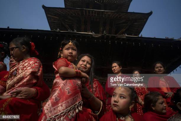 Young Nepalese girls dressed up as brides are accompanied by their mothers to take part in the Bel Bibaha ritual celebrated by the Newari ethnicity...
