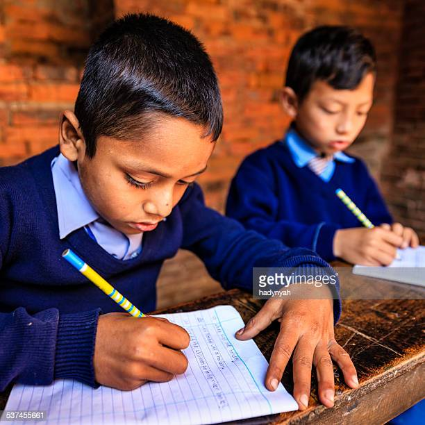 young nepali boys in classroom - nepal stock pictures, royalty-free photos & images
