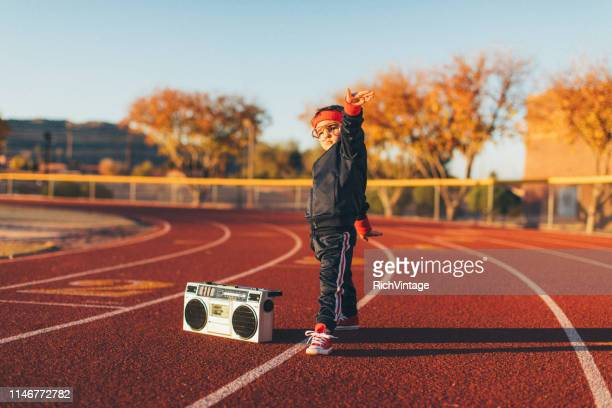 young nerd boy at track - imagination stock pictures, royalty-free photos & images