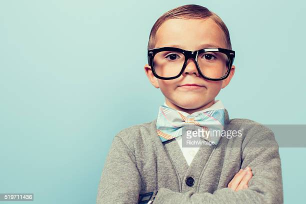 young nerd boy folding arms and blank expression - nerd stock pictures, royalty-free photos & images