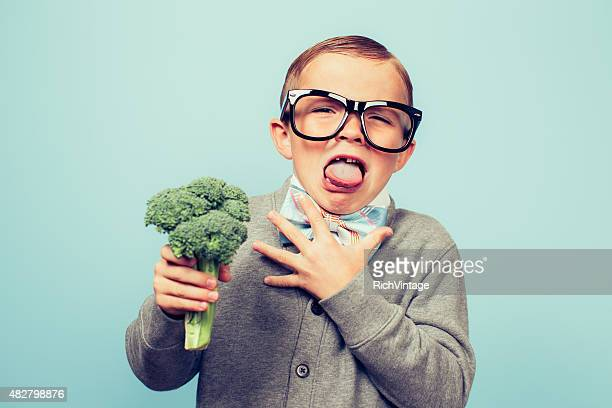 young nerd boy hates eating broccoli - furious stock pictures, royalty-free photos & images