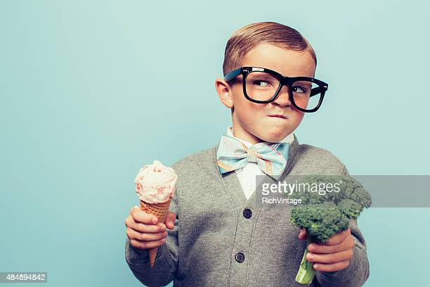 young nerd boy hates eating broccoli - negative emotion stock pictures, royalty-free photos & images