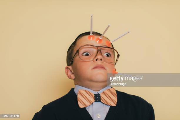 young nerd boy hit by dart - darts stock pictures, royalty-free photos & images
