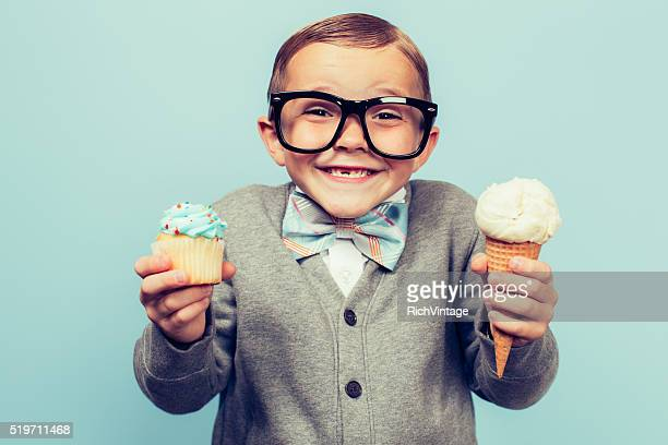young nerd boy holds ice cream and cupcakes - chubby boy stock photos and pictures