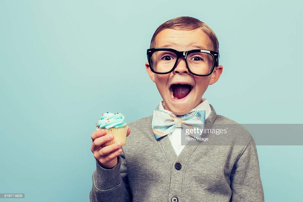 Young Nerd Boy Loves Dessert : Stock Photo