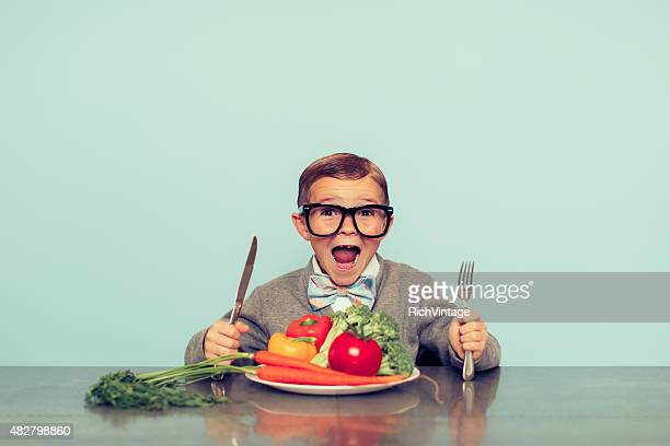 Young Nerd Boy Loves Eating Vegetables