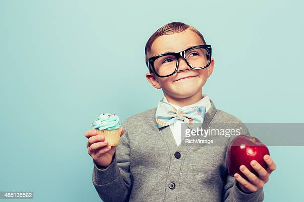 young nerd boy loves healthy food choices - choice stock pictures, royalty-free photos & images