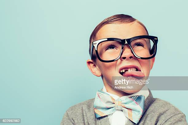 young nerd boy makes face - confusion stock photos and pictures
