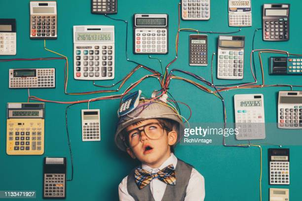 young nerd boy overworked with calculator invention - adult imitation stock pictures, royalty-free photos & images