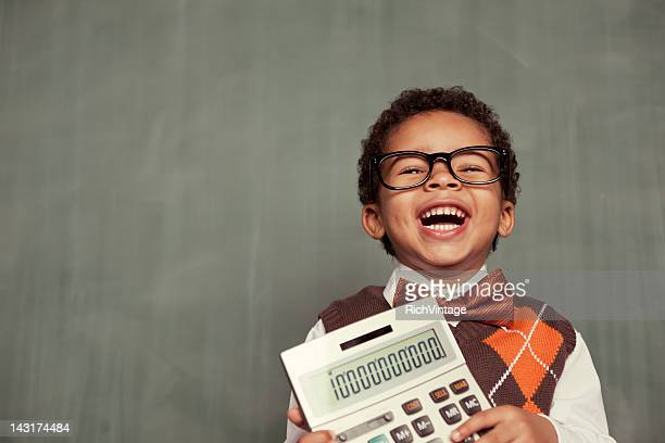young nerd boy wearing glasses holding calculator - calculator stock photos and pictures