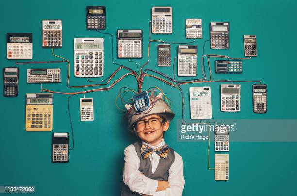young nerd boy with brilliant invention - fun calculator stock photos and pictures