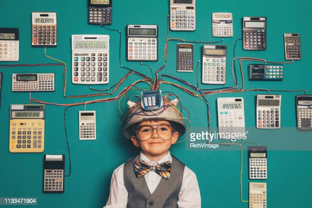 young nerd boy with calculator invention - mathematics stock pictures, royalty-free photos & images
