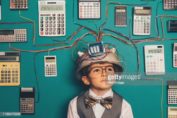 young nerd boy with calculator invention - adult imitation stock pictures, royalty-free photos & images
