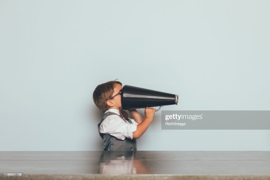Young Nerd Boy with Megaphone : Stock Photo