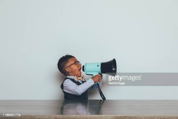young nerd boy with megaphone - debate stock pictures, royalty-free photos & images