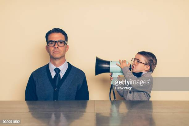 young nerd boy yelling at dad through megaphone - noise stock pictures, royalty-free photos & images