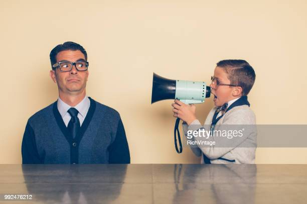 young nerd boy yelling at dad through megaphone - generation gap stock pictures, royalty-free photos & images