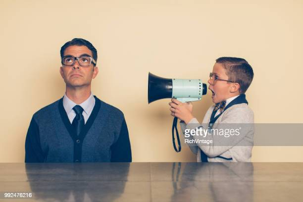 Young Nerd Boy Yelling at Dad through Megaphone