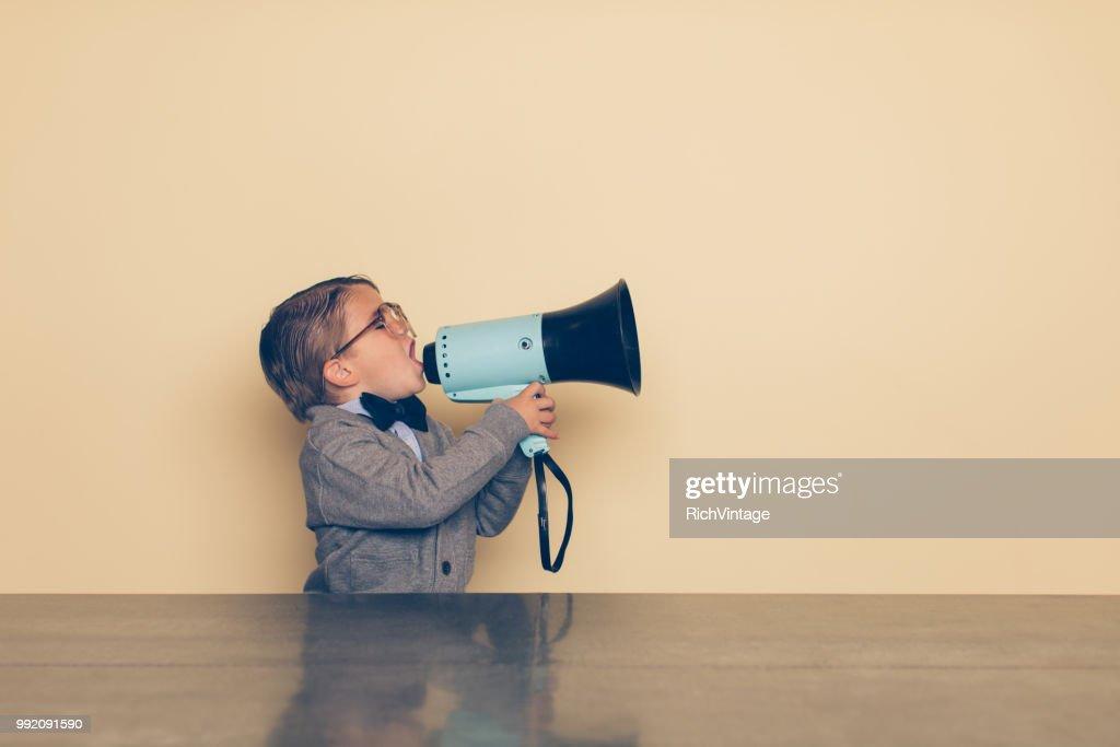 Young Nerd Boy Yells into Megaphone : Stock Photo