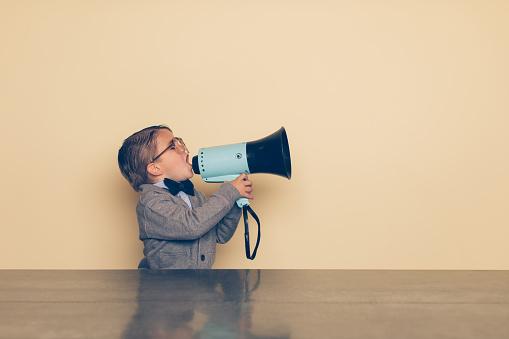 Young Nerd Boy Yells into Megaphone 992091590