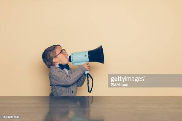 young nerd boy yells into megaphone - shouting stock photos and pictures