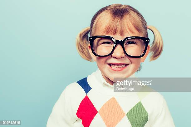 young nerd girl with big smile on face - girl nerd hairstyles stock photos and pictures