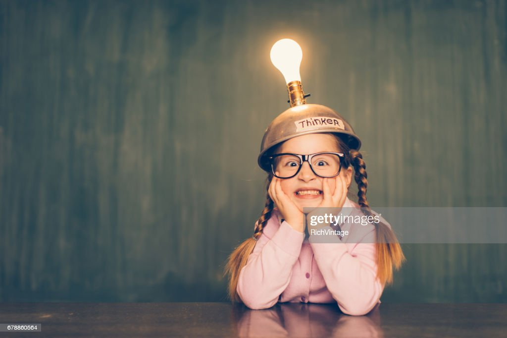 Young Nerd Girl With Thinking Cap : Stock Photo