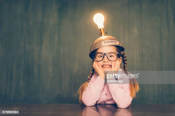 Young Nerd Girl With Thinking Cap