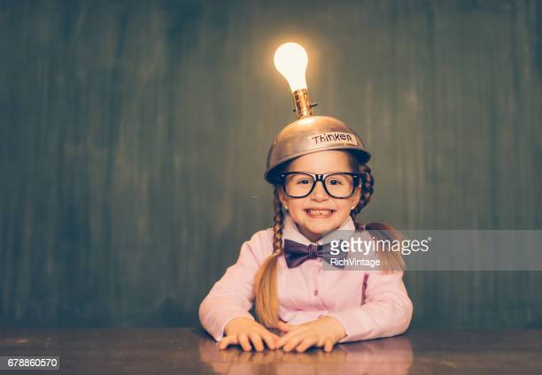 young nerd girl with thinking cap - nerd girl stock photos and pictures