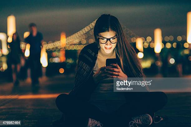 young nerd woman texting on the phone - nerd girl stock photos and pictures