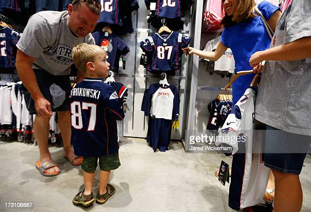 Young New England Patriots fans tries on a Rob Gronkowski jersey after exchanging their Aaron Hernandez jerseys during a free exchange at the pro...