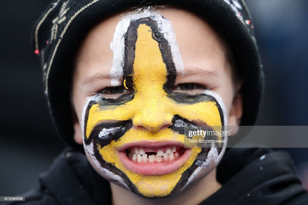 A young New Orleans Saints fan smiles before a game against the Buffalo Bills on November 12, 2017 at New Era Field in Orchard Park, New York.