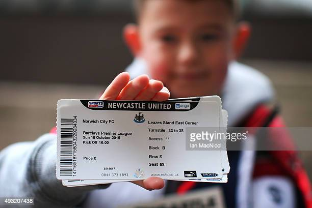 A young Newcastle fan shows off his match ticket during the Barclays Premier League match between Newcastle United and Norwich City at St James Park...