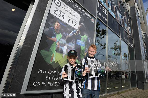 Young Newcastle fans arrive at the stadium during the Barclays Premier League match between Newcastle United and Leicester City at St James' Park on...