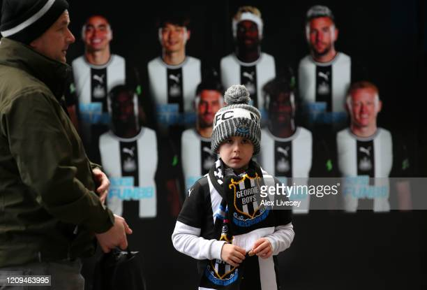 Young Newcastle United fan looks on prior to the Premier League match between Newcastle United and Burnley FC at St. James Park on February 29, 2020...