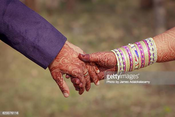 young newly married couple holding hands - hinduism stock pictures, royalty-free photos & images