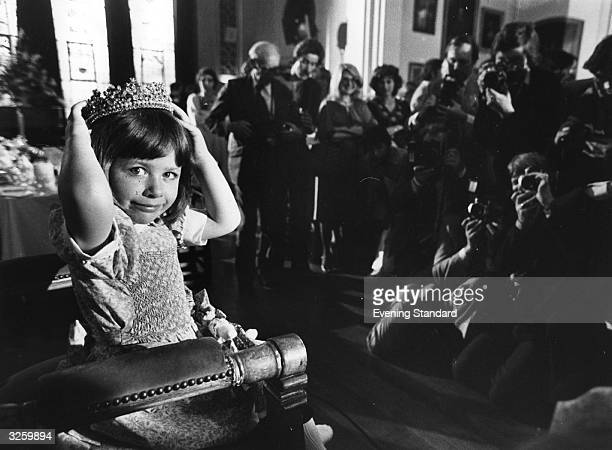 Young newlycrowned beauty queen Christine Cashman is photographed sitting on her throne