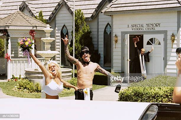 Young Newlywed Couple Standing Outside a Church