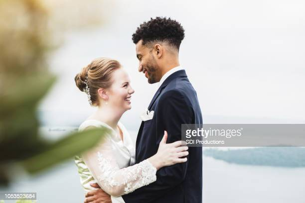 young newlyweds embracing - wedding vows stock pictures, royalty-free photos & images